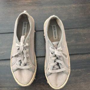 Gray Steve Madden sneakers.